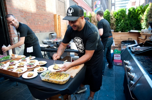 Andrew Richmond and Steve Gonzales making tacos for La Carnita