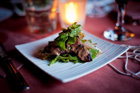 Grilled lamb heart, rocket, shallots, garden beans with a pickled walnut dress, The Feasting Room